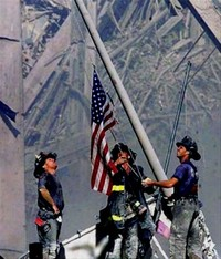 911 firefighters-raise-flag
